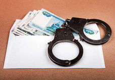 Russian Rubles and Handcuffs Stock Photo