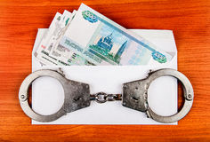 Russian Rubles and Handcuffs Royalty Free Stock Photos