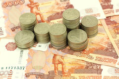 Russian rubles and a handful of coins Royalty Free Stock Photography