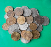 Russian rubles and kopecks. A handful of coins. Coins of different values on the heap. Russian rubles and kopecks. Russian money. Money on a green background stock photography