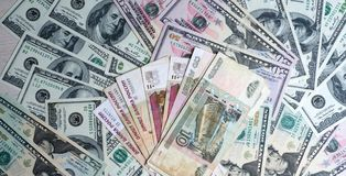Russian rubles on a pile of dollars Stock Photo