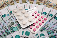 Russian rubles and pills Stock Images