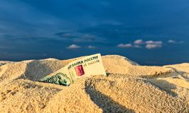 Russian  rubles is on a sand Royalty Free Stock Images