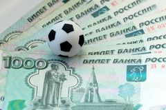 Russian rubles and soccer ball. The concept of costs and revenues for the World Cup, fans, footballers and coaches, sports betting. Russian rubles and soccer royalty free stock photo