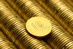 Russian rubles stack of metal gold coins background. Money Stock Photo