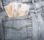 Russian rubles stick out of a hip-pocket of jeans Stock Photo