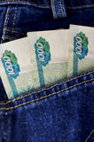 Russian rubles stick out of a hip-pocket  jeans Stock Photography
