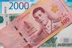 Russian rubles and Thai baht close-up. Ruble-butt rate. royalty free stock images