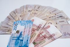 Russian rubles and Thai baht close-up. Ruble-butt rate royalty free stock photos