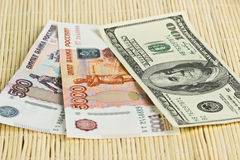 Russian rubles and US dollars on background napkins Stock Photography
