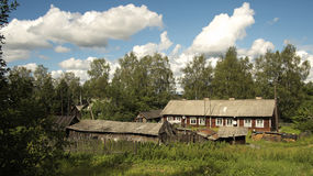 Russian rural house. Russian North. Vologda region. Rural house with outbuildings. Typical housing for local residents Stock Photos