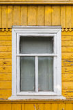 Russian rural house, yellow wall and white window Royalty Free Stock Photos