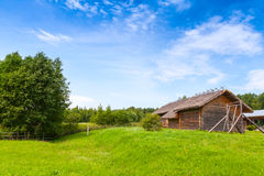 Russian rural landscape with old wooden barns Royalty Free Stock Photography