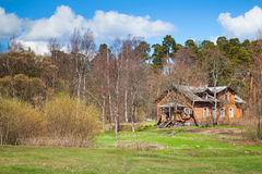 Russian rural landscape with old wooden house Royalty Free Stock Photos