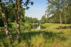 Russian rural landscape. Typical Russian rural landscape with river, forest and clear blue sky Royalty Free Stock Photography
