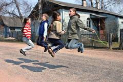 Russian, rural schoolchildren during recess, jumping rope Royalty Free Stock Photography