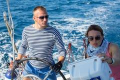 Russian sailors participate in sailing regatta 16th Ellada Autumn 2016 among Greek island group. ERMIONI, GREECE - SEP 28, 2016: Sailors participate in sailing Stock Photo