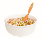 Russian salad. In bowl isolated on white background Royalty Free Stock Photo