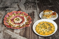 Russian Salad with Appetizer Savory Dish Meze and Spinach Cheese Pie Zeljanica on Old Cracked Wooden Garden Table Stock Image