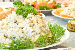 Russian salad - Banquet in the restaurant Stock Photo
