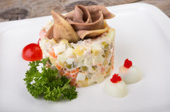 Russian salad with beef tongue Stock Images