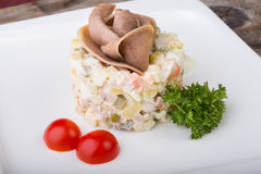 Russian salad with beef tongue Royalty Free Stock Photos