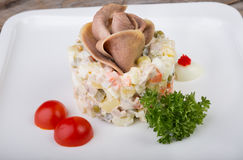 Russian salad with beef tongue Royalty Free Stock Images