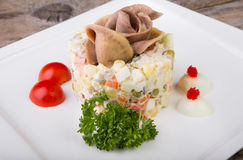 Russian salad with beef tongue Stock Image