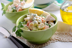 Russian salad in the bowl. Russian salad with boiled eggs inside green bowl Stock Photography