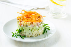 Russian salad Olivier with carrot on the top Stock Photography