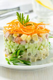 Russian salad Olivier with carrot on the top Stock Photos