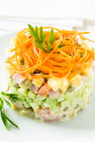 Russian salad Olivier with carrot on the top Royalty Free Stock Image