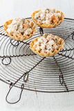 Russian salad olivier in portioned baskets Stock Photo