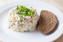 Russian salad olivier served with onion Stock Image