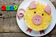 Russian salad olivier shaped yellow pig as symbol of new year 2019. Russian salad olivier shaped yellow pig as a symbol of new year 2019 royalty free stock photo
