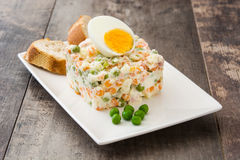 Russian salad. On a rustic wooden table Royalty Free Stock Photography