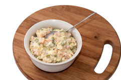 Russian salad served in the bowl on the wooden board Royalty Free Stock Photos