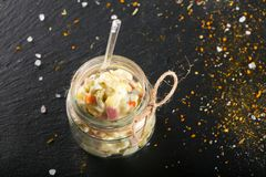 Russian salad in the glass can Stock Photography