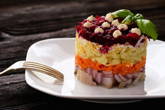 Russian salad with vegetables and herring. Stock Photo