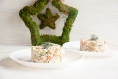 Russian salad on a white plate. Perfect tasty lunch or dinner: Russian salad on a white plate royalty free stock photo