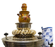 Russian samovar. And steering-wheels on a white background Royalty Free Stock Photo