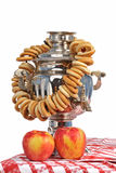 Russian samovar with bagels and apples Stock Image