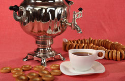 Russian samovar with bagels and cups of tea Stock Photo