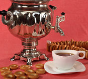 Russian samovar with bagels and cups of tea Royalty Free Stock Photos