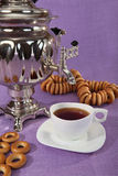 Russian samovar with bagels and cups of tea Stock Photos