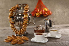 Russian samovar with bagels and cups of tea Royalty Free Stock Image