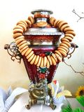 Russian samovar with bagels stock images