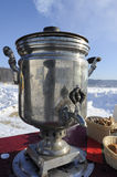 Russian samovar. Boiling samovar in a snowy field lit by the sun Stock Images
