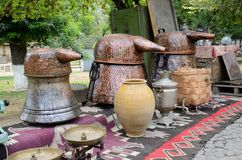Russian samovar and old copper tanks for making grape vodka Royalty Free Stock Images