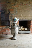 Russian samovar. Russian furnace on the background Royalty Free Stock Images
